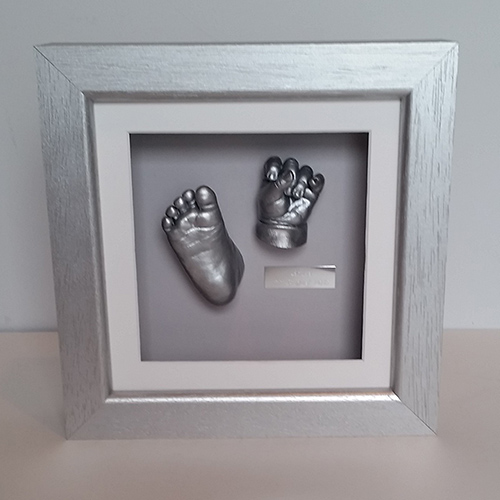 Luxury Hardwood 8x8 Square Silver frame with White front mount, Grey back mount and silver casts of a 6 month old baby