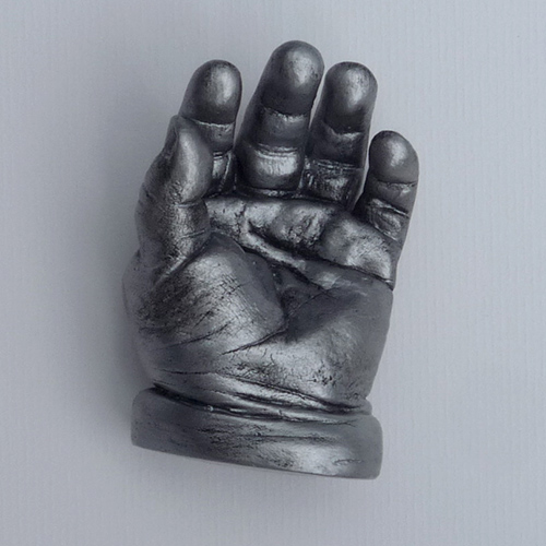 Antique silver hand cast of an 8 month old
