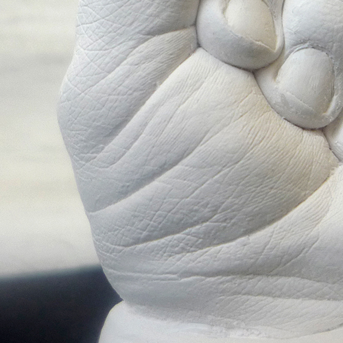 Close up of a white hand cast of a 6 month old