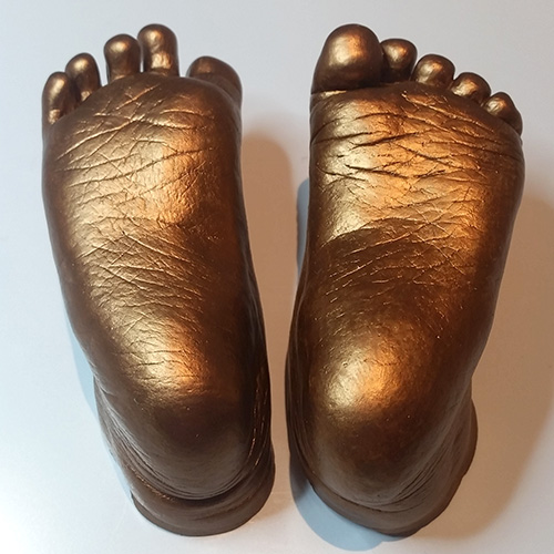 Gold feet casts of a 1 year old