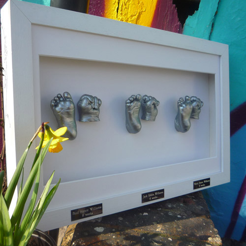 Classic 16x10 White frame with silver casts of 6 week old triplets