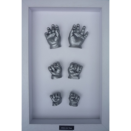 Contemporary 16x10 Single White frame with silver hand casts of a baby's first year at 6 weeks, 6 months and 1 year