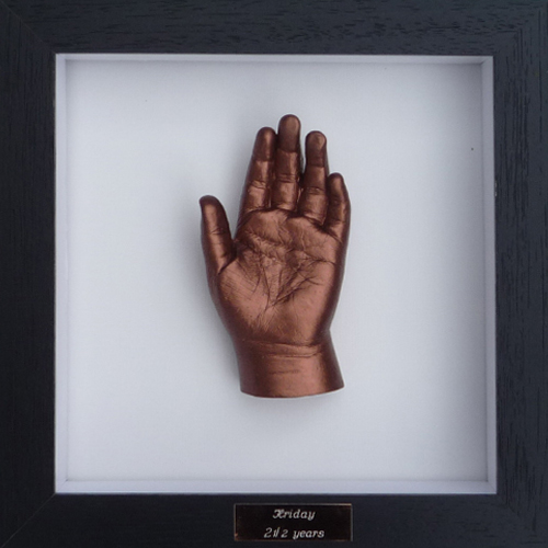 Contemporary 8x8 Square Black frame with a bronze hand cast of a 3 year old