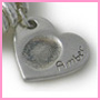 Heart-shaped fingerprint charm