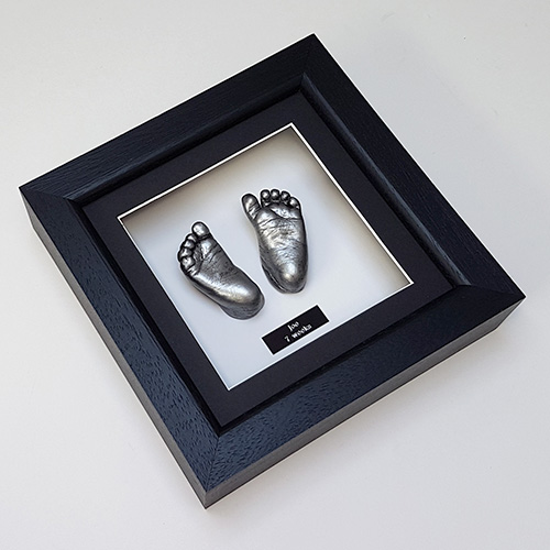 Luxury Hardwood 8x8 Black frame with antique silver feet cast of a 7 week old