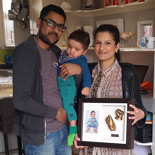 Happy parents collecting their son's casts in a Luxury Hardwood 12x10 Double frame