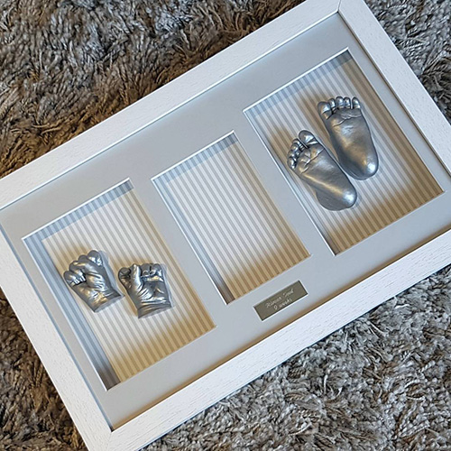 Classic 16x10 Triple White frame with silver casts and stripey background (waiting for photo!)