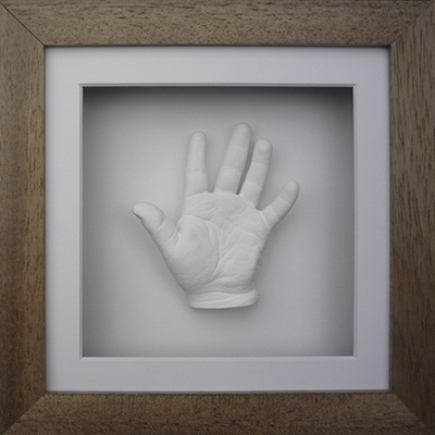 Classic 8x8 Square Oak frame with a white hand cast of a 4 year old