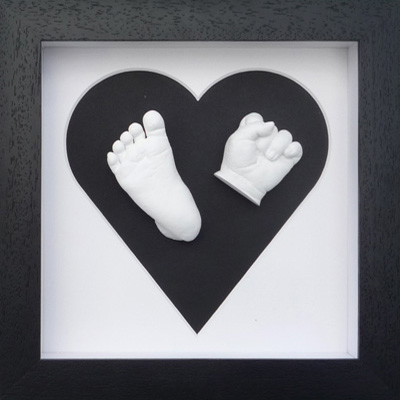 Classic 8x8 Square Black heart frame with white casts of a 5 month old
