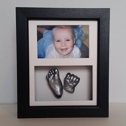 Luxury Hardwood 10x8 Double Black frame with white mounts and silver casts of a 4 month old baby