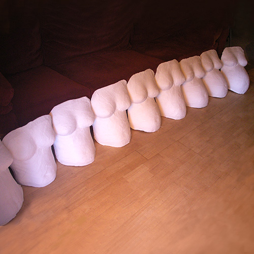 Nine pregnant belly casts - one made each month