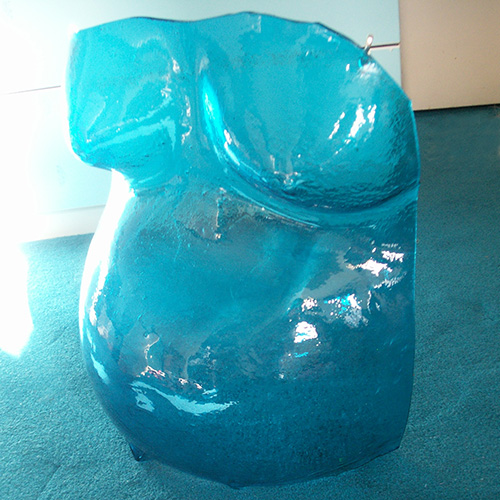 Pregnant belly cast in blue glass