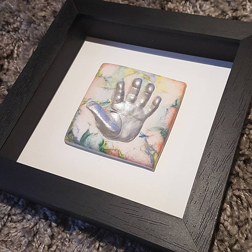 Classic 8x8 Square black frame with marbled clay hand with siilver print.