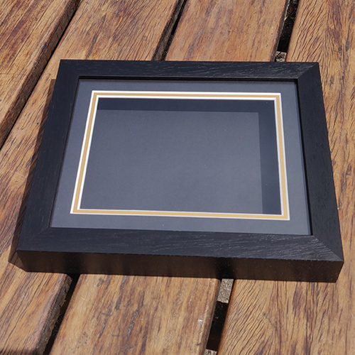 Classic 10x8 Black frame with Black mounts and Gold under mount.